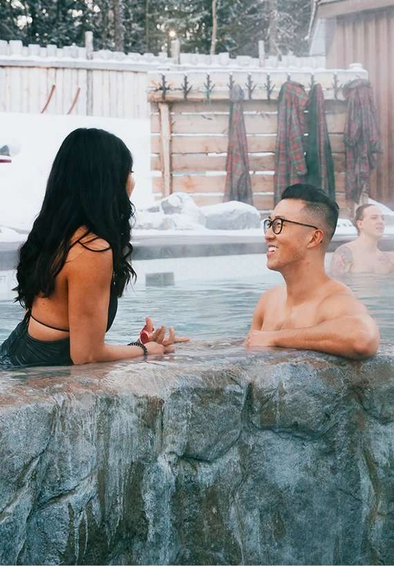 couple sitting in pool