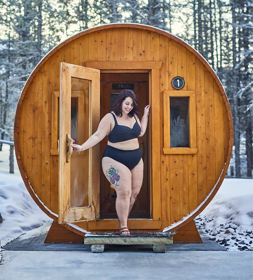 woman coming out of barrel steam cabin