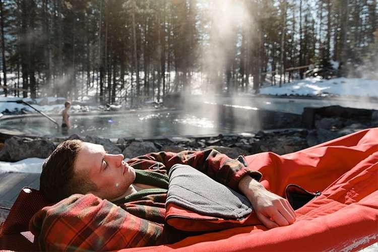 man laying in an outdoor hammock